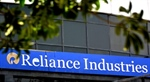 Reliance Industries announces demerger of its oil to chemical business; stock trades positively